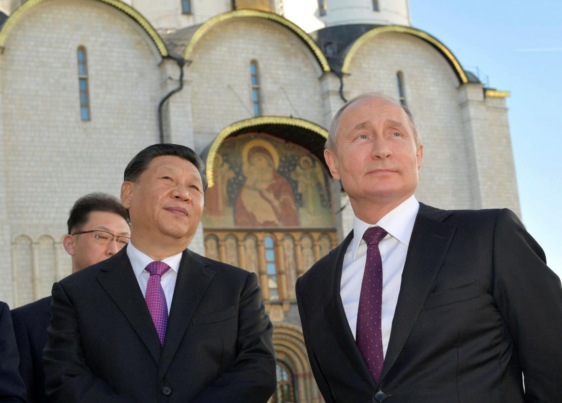 'Best friends' Xi and Putin. Credit: PA
