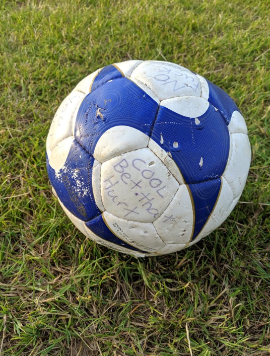 Someone had filled the ball with concrete and written messages on it. Credit: Facebook