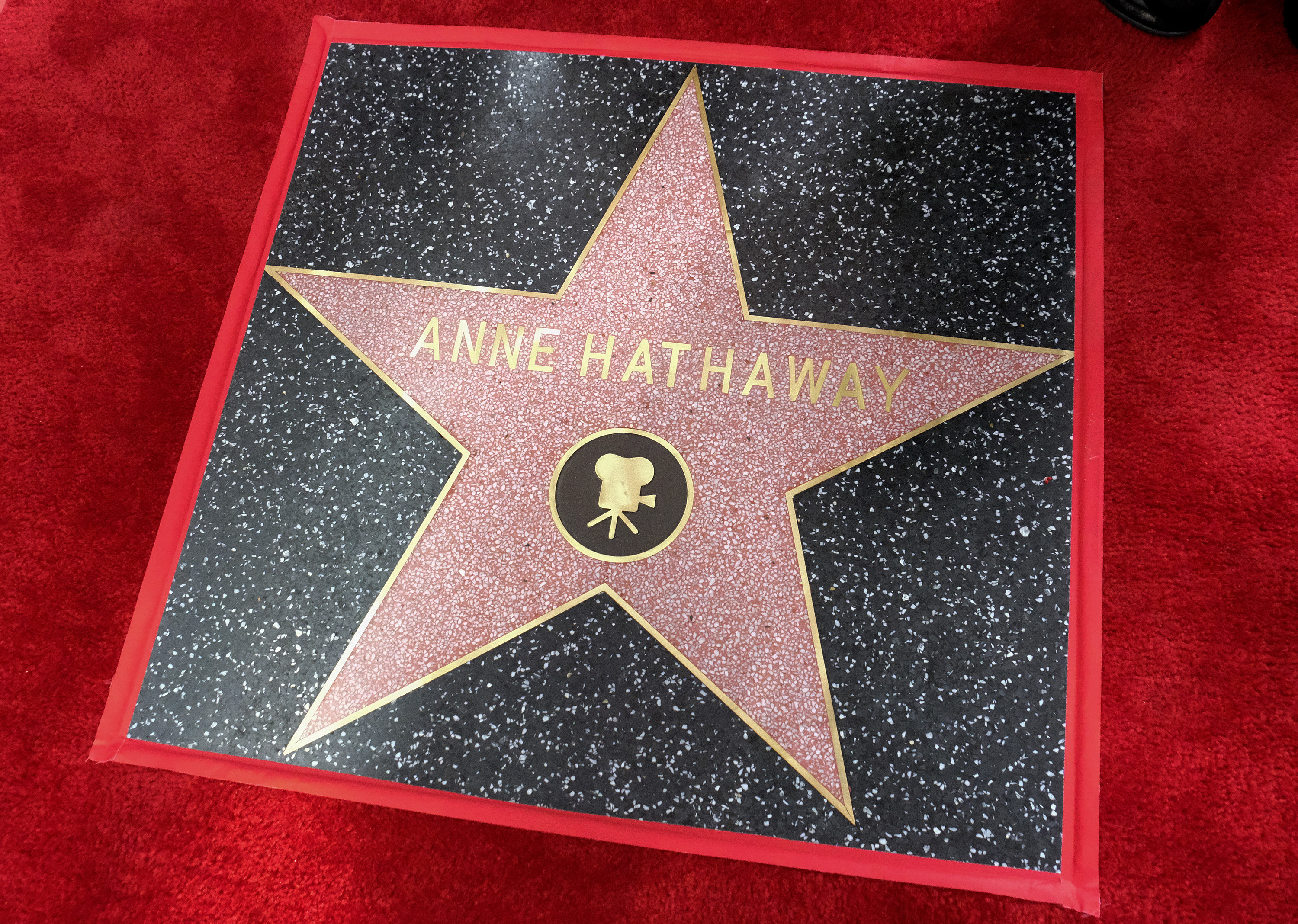Hathaway has been honoured with a star on the Hollywood Walk of Fame. Credit: PA
