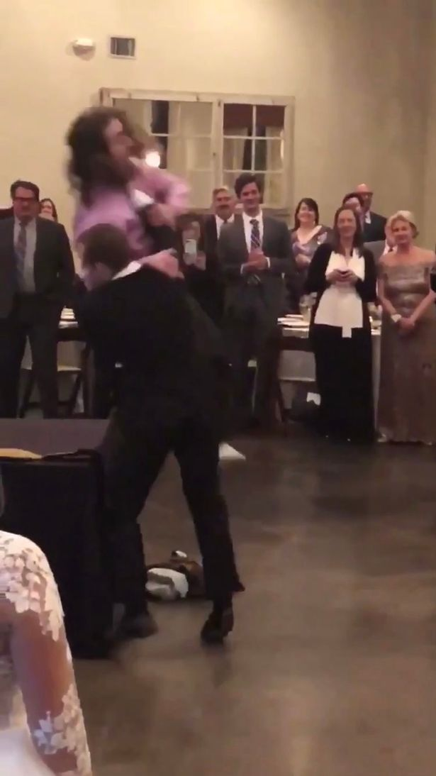 The groom and best man put on a show for the wedding guests. Credit: Triangle News