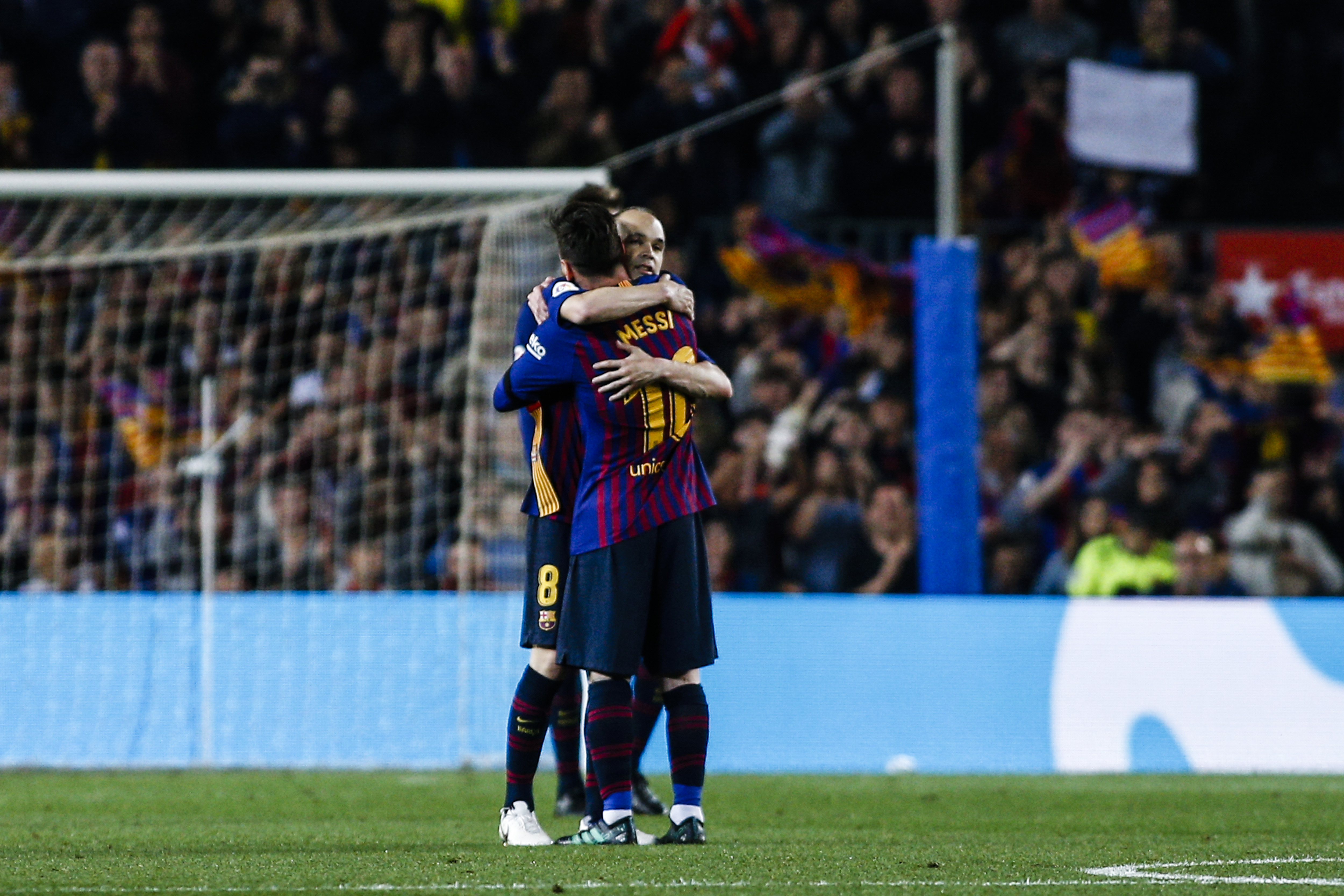 Iniesta hugs Messi on his final Camp Nou outing. Image: PA