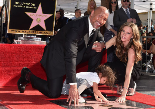Dwayne 'The Rock' Johnson with his partner Lauren Hashian and daughter Jasmine Johnson.