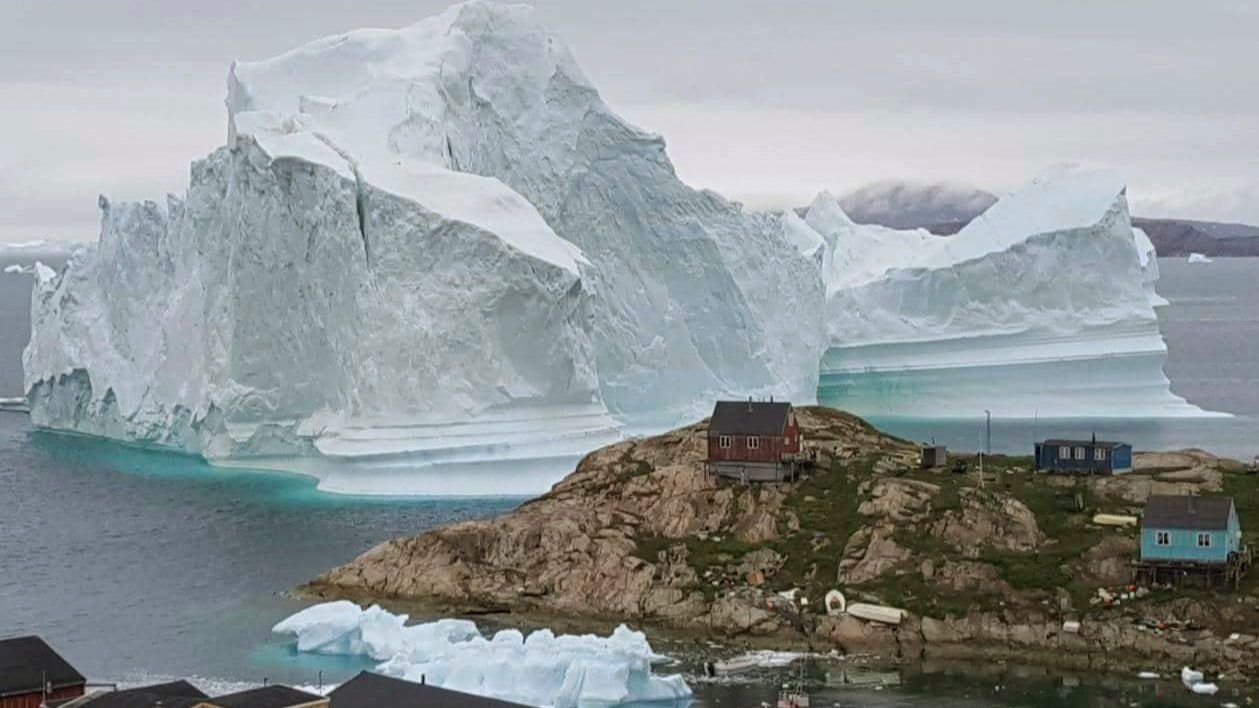 Huge iceberg looms over Greenland settlement
