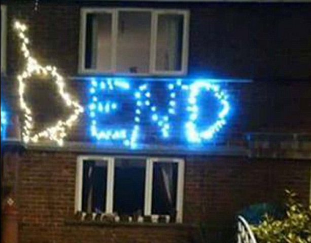 Father-of-Four Refuses To Take Down Offensive X-Mas Lights Down As He's Naked