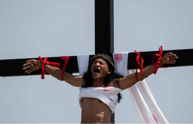 The 58-year-old was crucified for the 33rd time, this year. Credit: Getty
