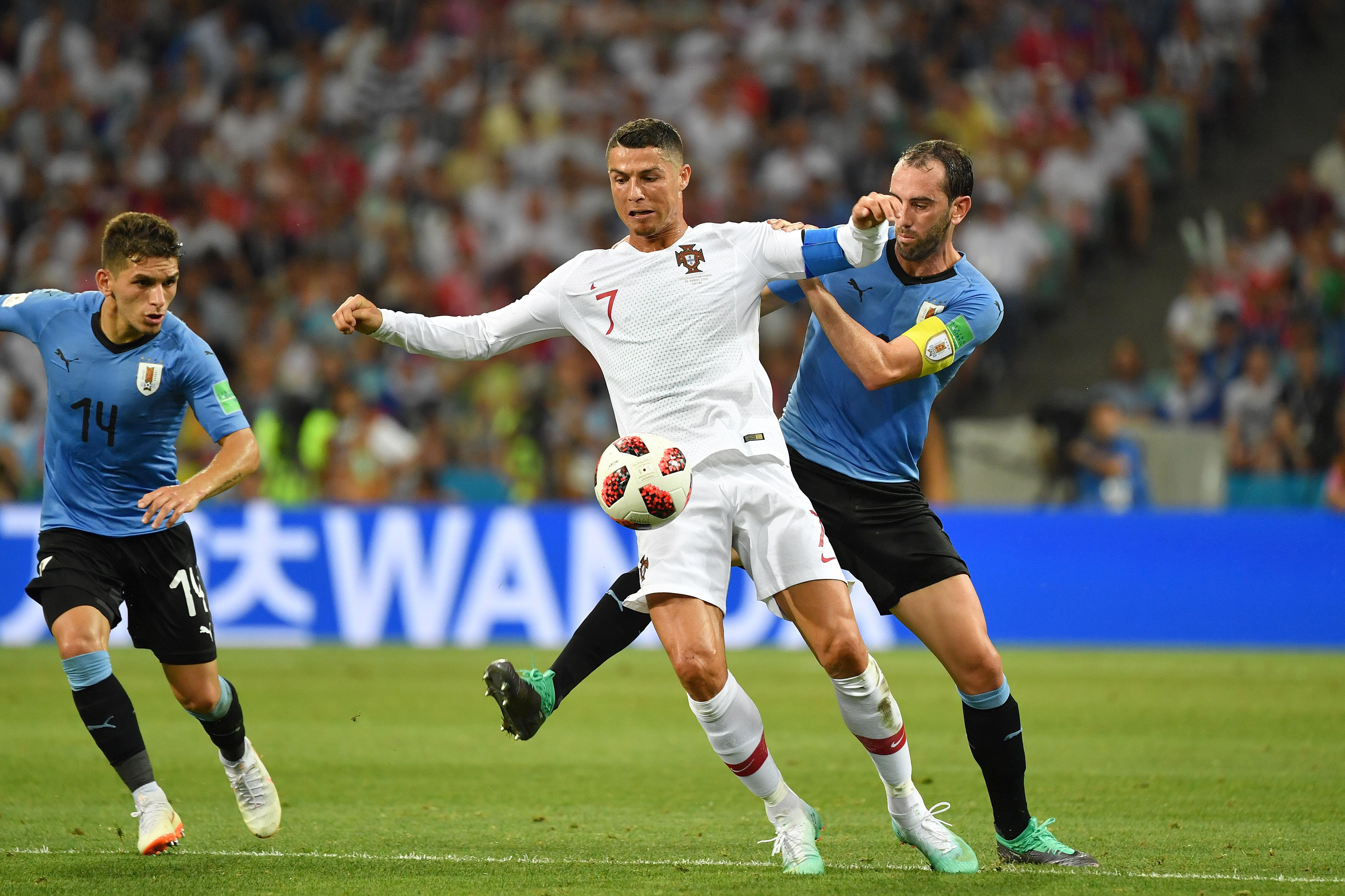 Godin and Ronaldo on international duty. Image: PA