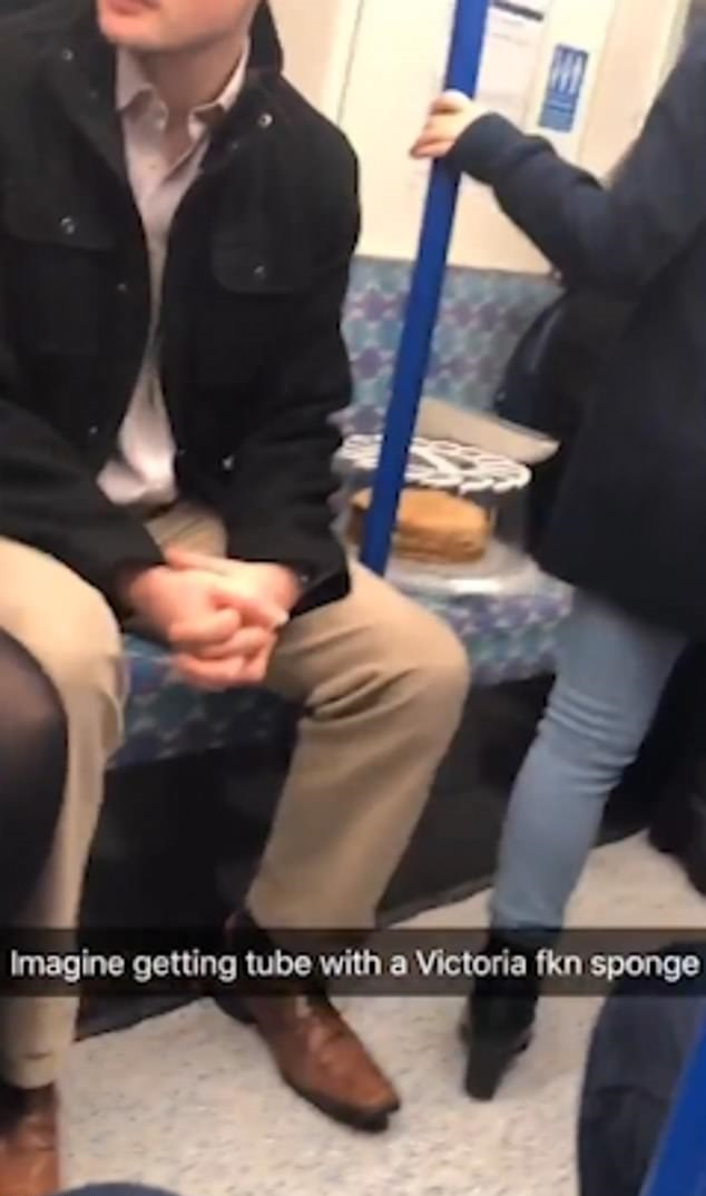 The cake rides the London Underground in relative comfort. Credit: Twitter