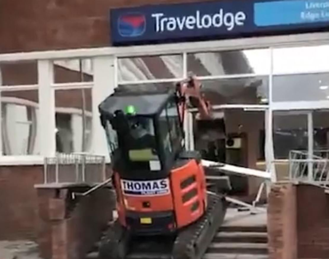 Man smashes Travelodge with digger 'because he hadn't been paid on time'