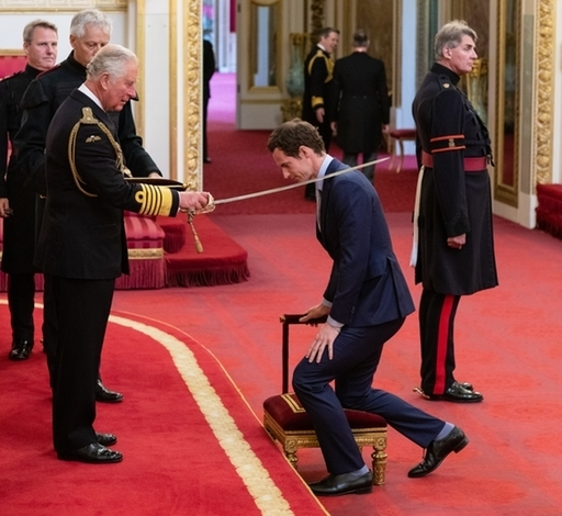 Andy Murray receiving his knighthood. Credit: PA