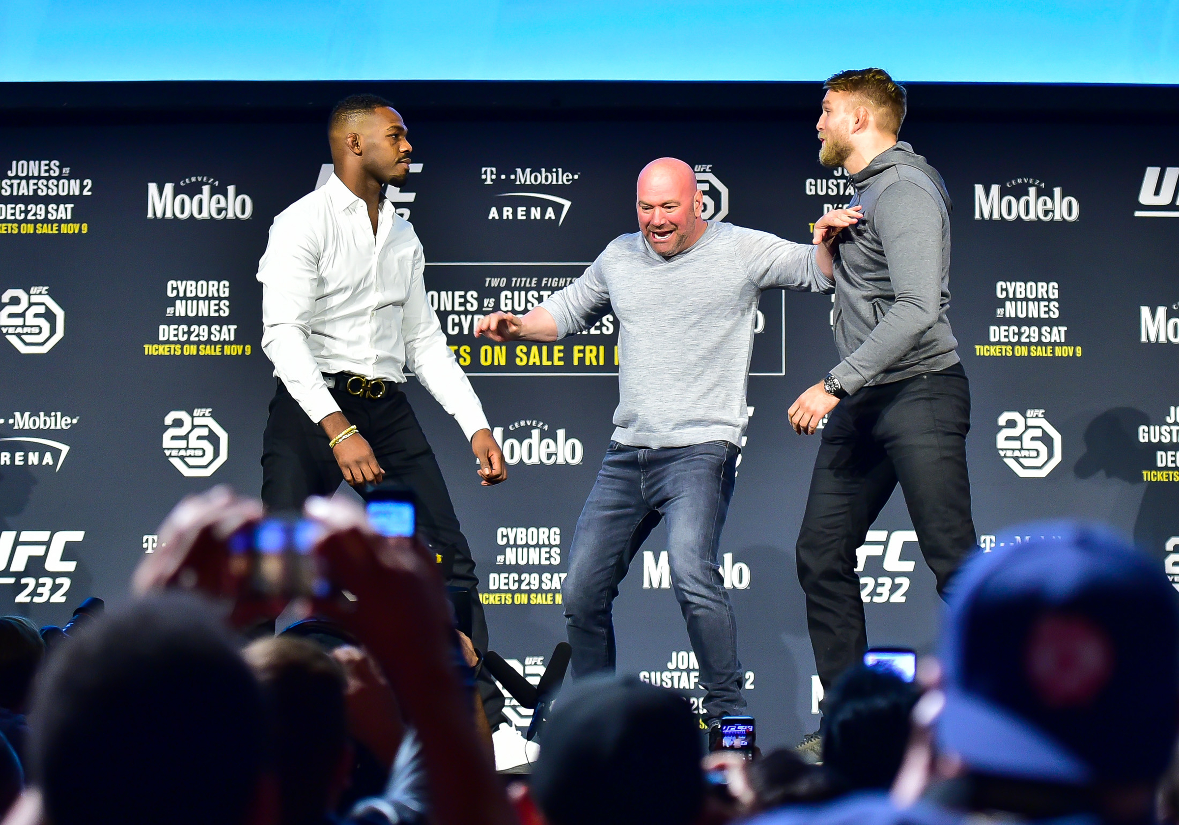 Dana White keeps the pair apart during a pre fight press conference. Image: PA Images