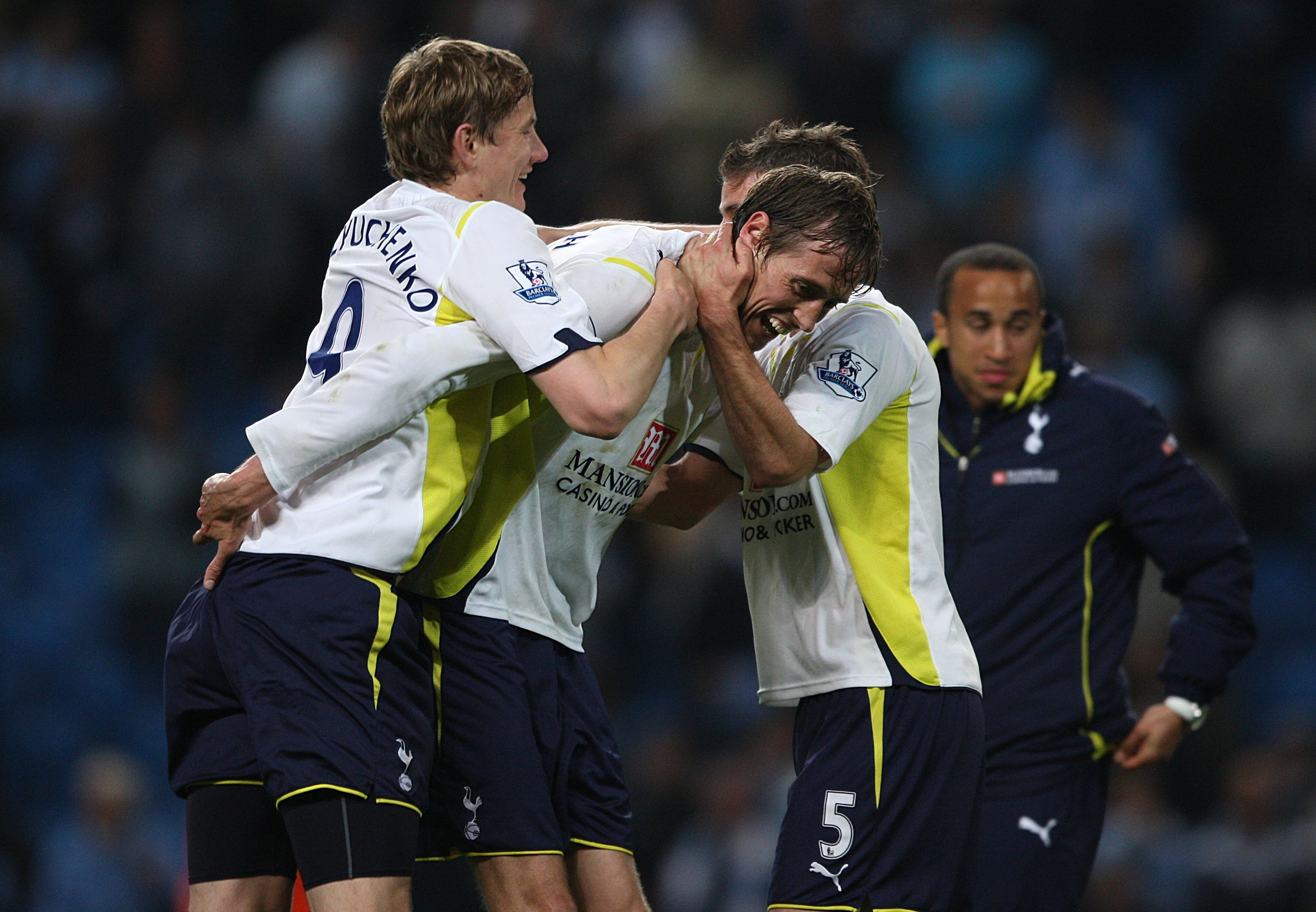 Crouch mobbed by Spurs teammates after scoring against City. Image: PA Images