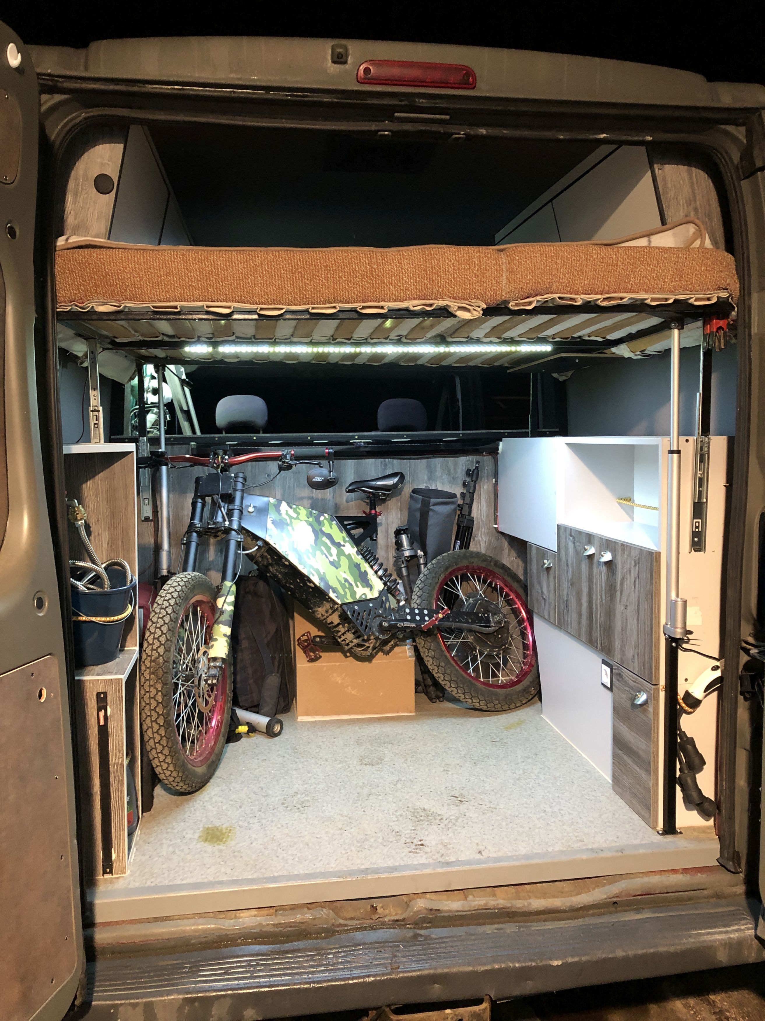 The van has a built in 'garage' to keep bikes. Credit: Kennedy News