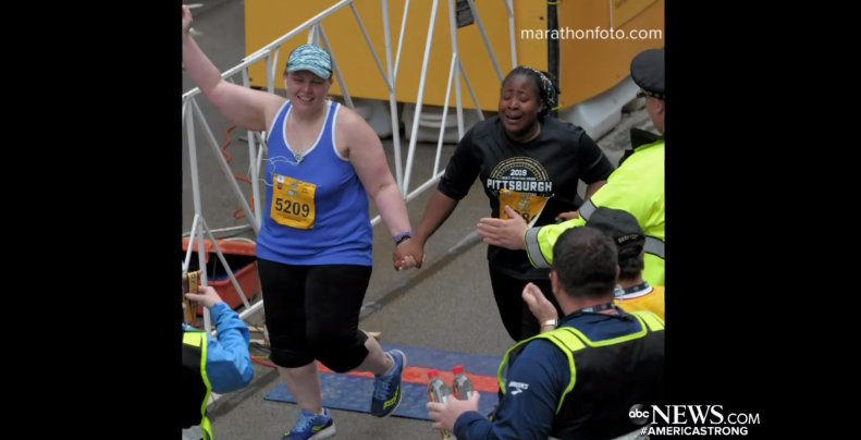 The two runners crossing the finish line. Credit: ABC