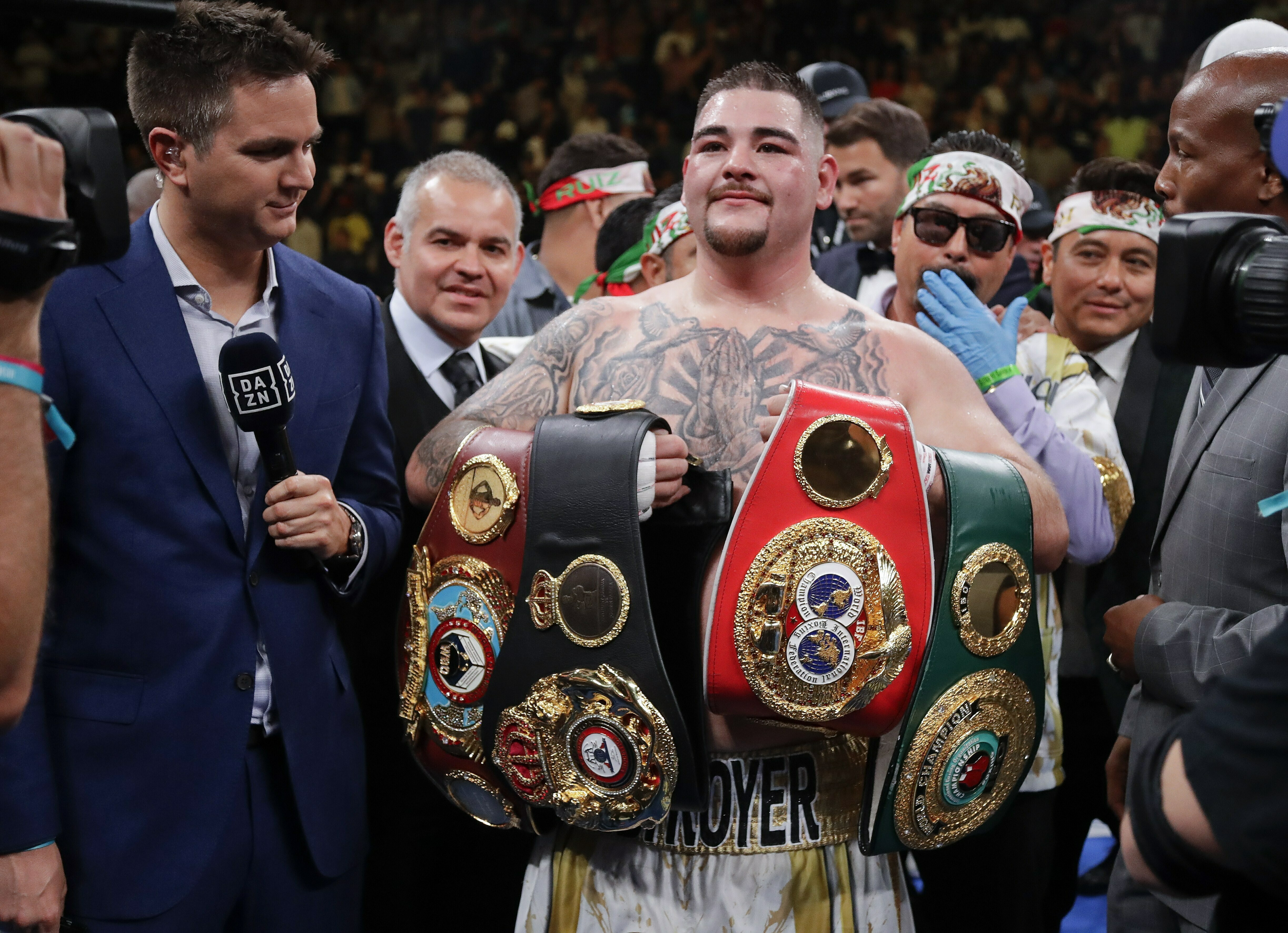 Ruiz holding all his titles. Image: PA Images