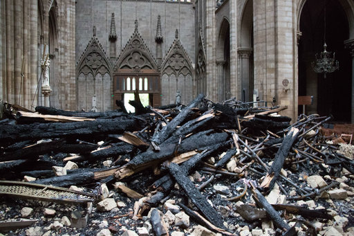 A picture taken on April 16, 2019 shows the altar surrounded by charred debris inside the Notre-Dame Cathedral. Credit: PA