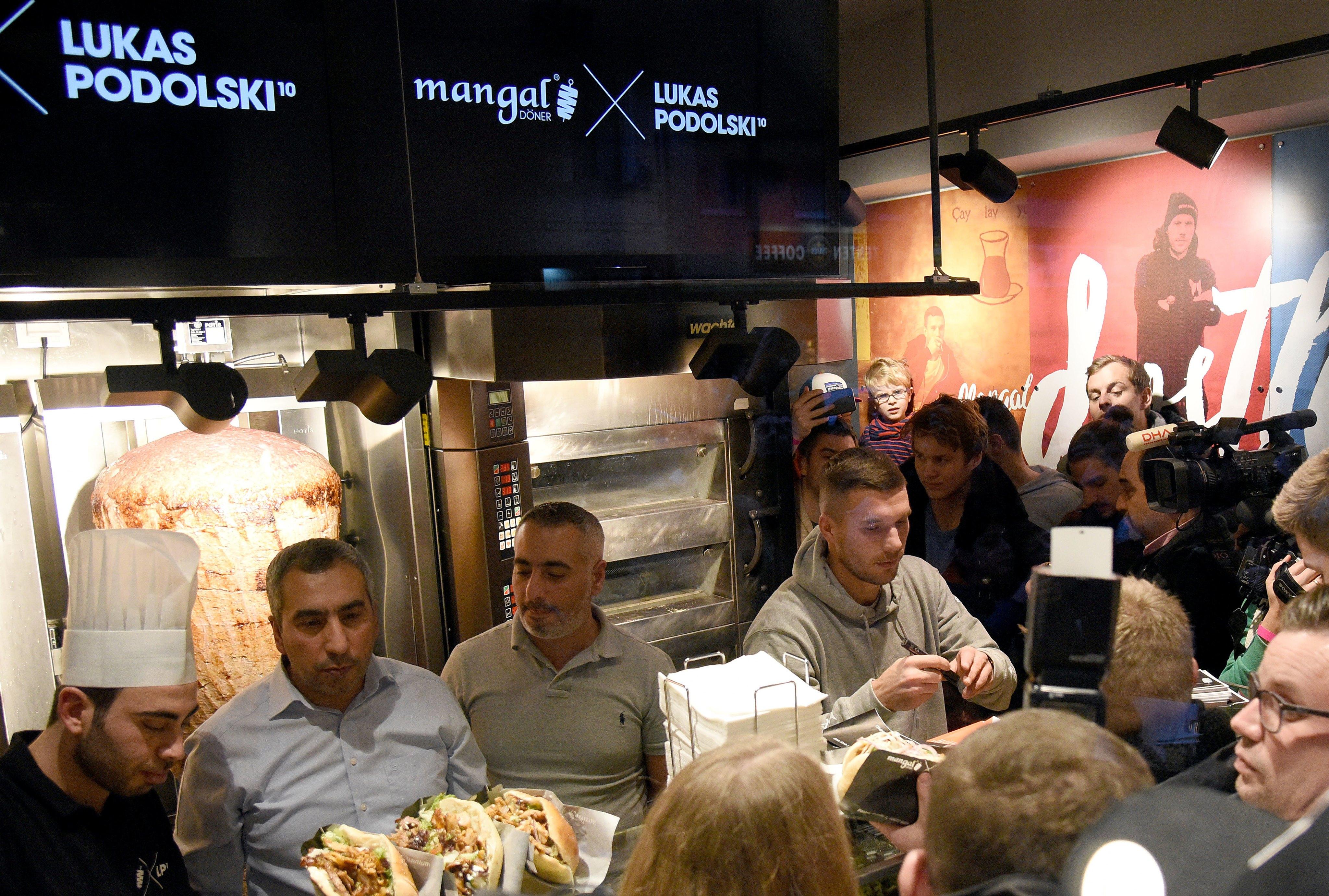 Podolski opens kebab restaurant