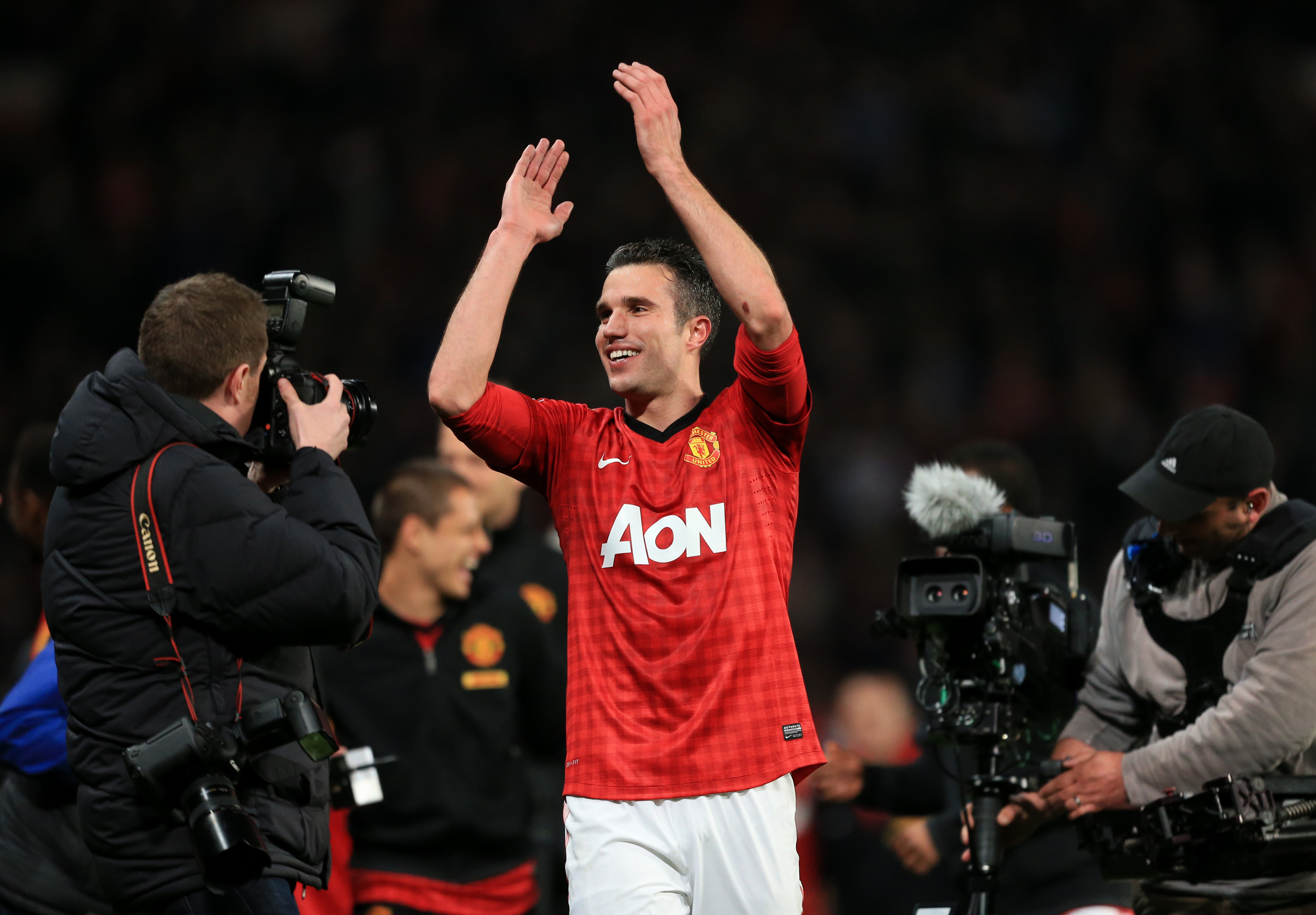 Van Persie celebrates winning the Premier League with United. Image: PA Images