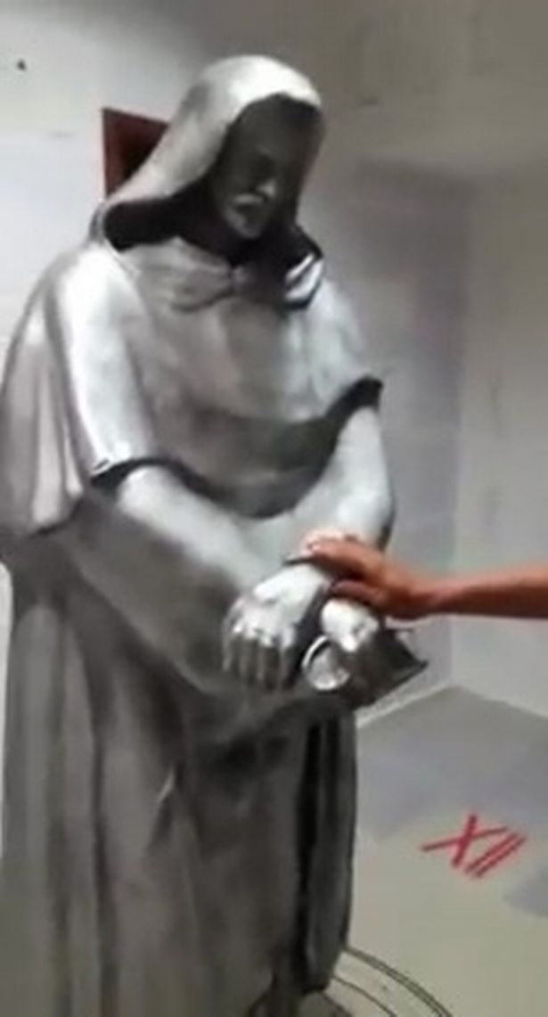 This £2,000 statue was also found in his room. Credit: Guilherme Kaminski dos Santos/Youtube