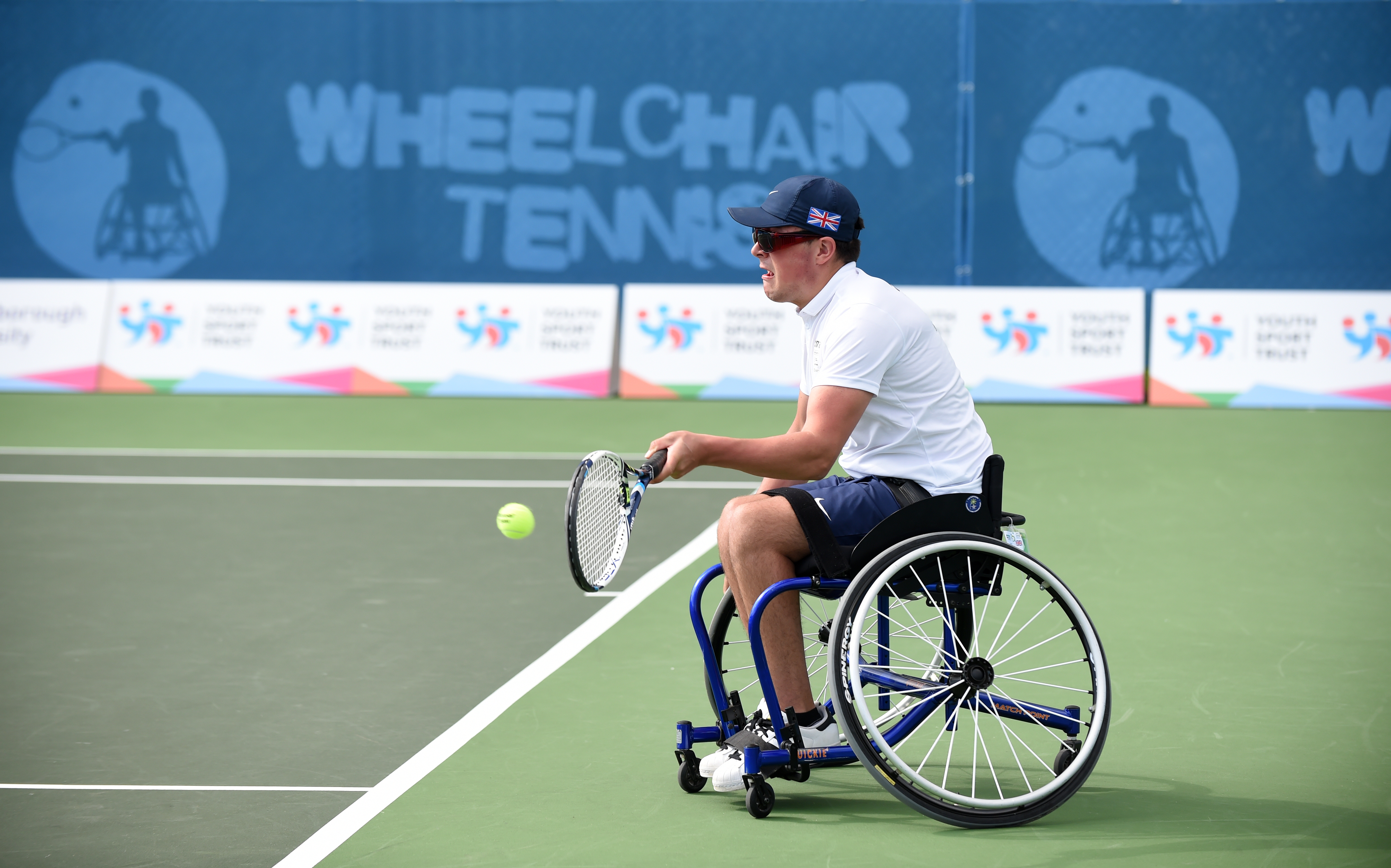 Wheelchair tennis is hard enough without a slope. Credit: PA