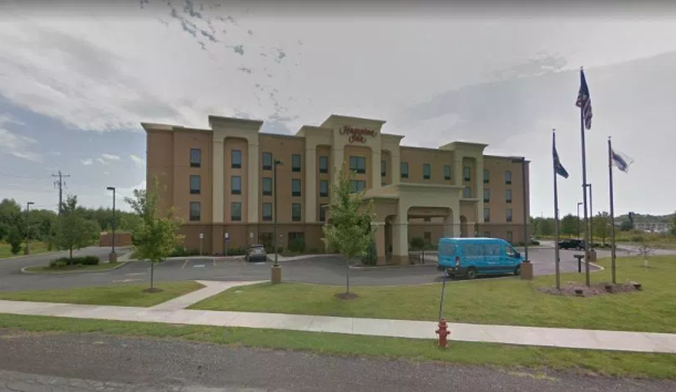 The pair allegedly had sex in a parked car behind the Hampton Inn. Credit: Google Maps