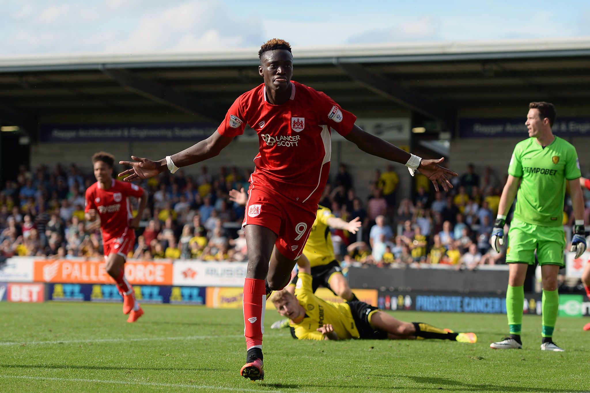 Abraham wheels away in celebration after scoring a goal for Bristol City. Image: PA