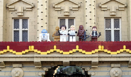 Luke Skywalker and Princess Leia are joined on the balcony of Buckingham Palace by (from left to right) R2-D2, C-3PO, Chewbacca and Han Solo. Credit: PA