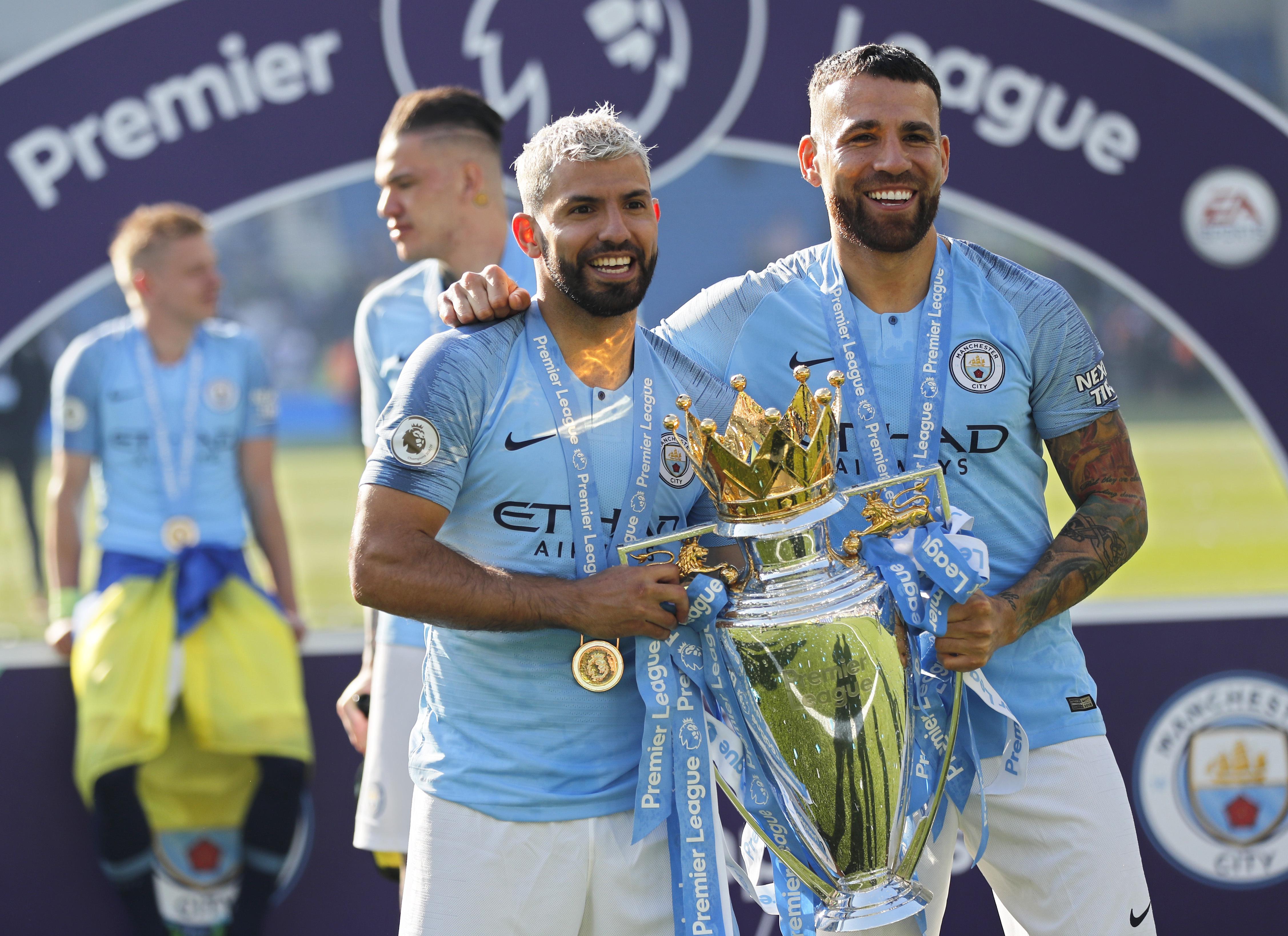Credit: PA. Otamendi (right) and Sergio Aguero celebrate winning the Premier League.