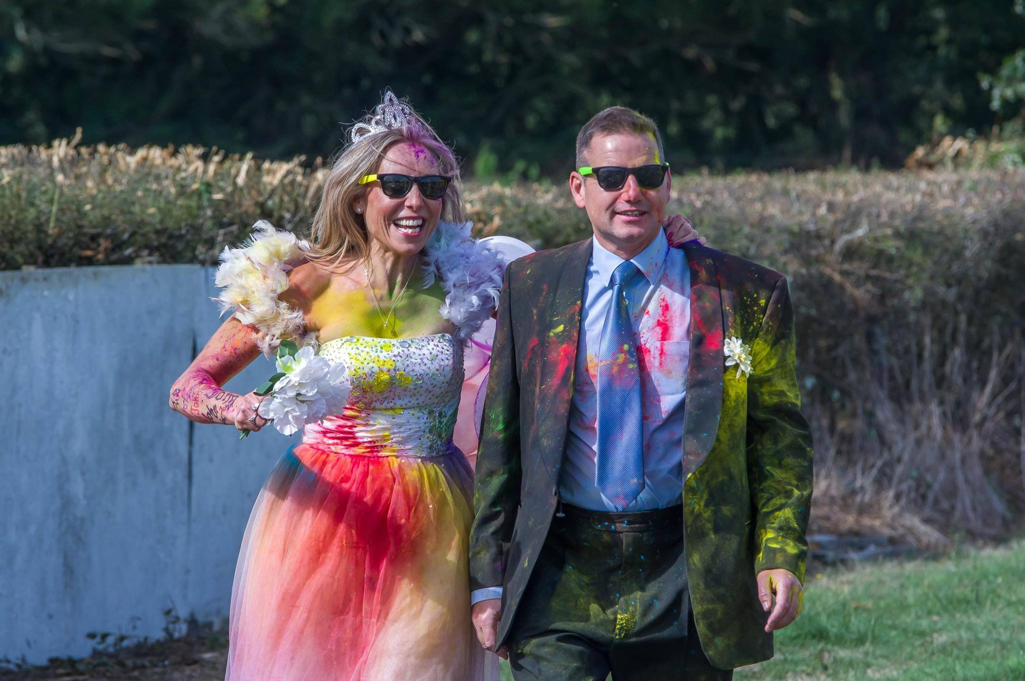 Michelle and John taking part in the Age UK colour run the day after their wedding. Credit: Michelle Walton