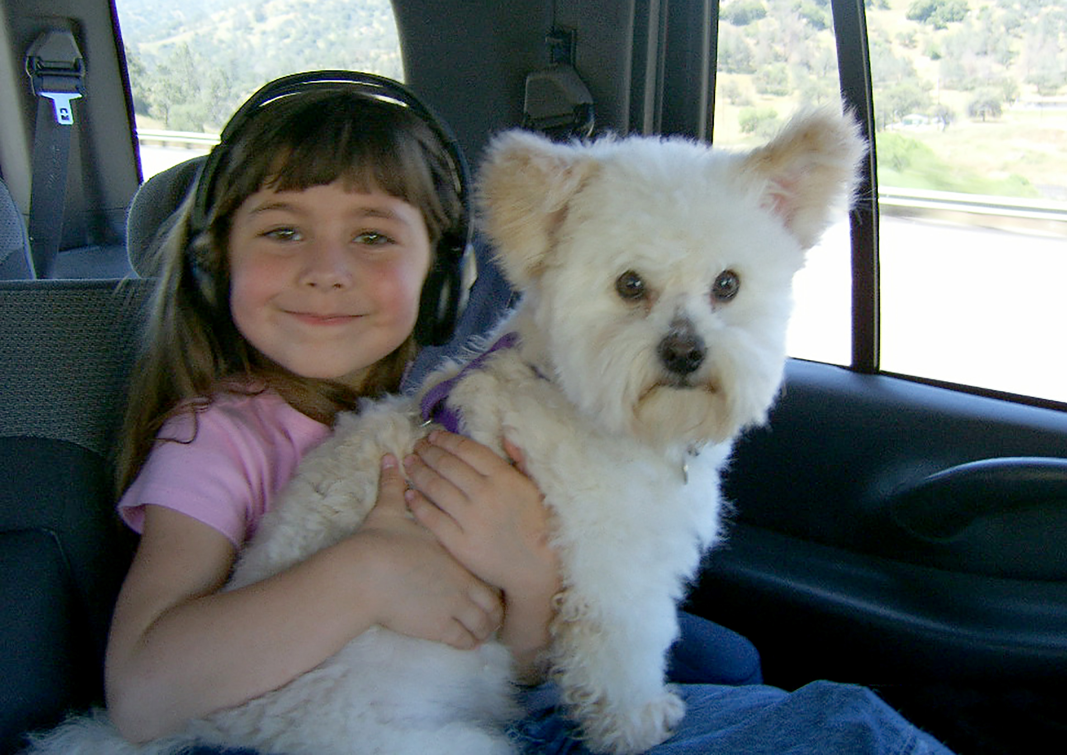 Gizmo with Kira when she was four. Credit: Kennedy News and Media