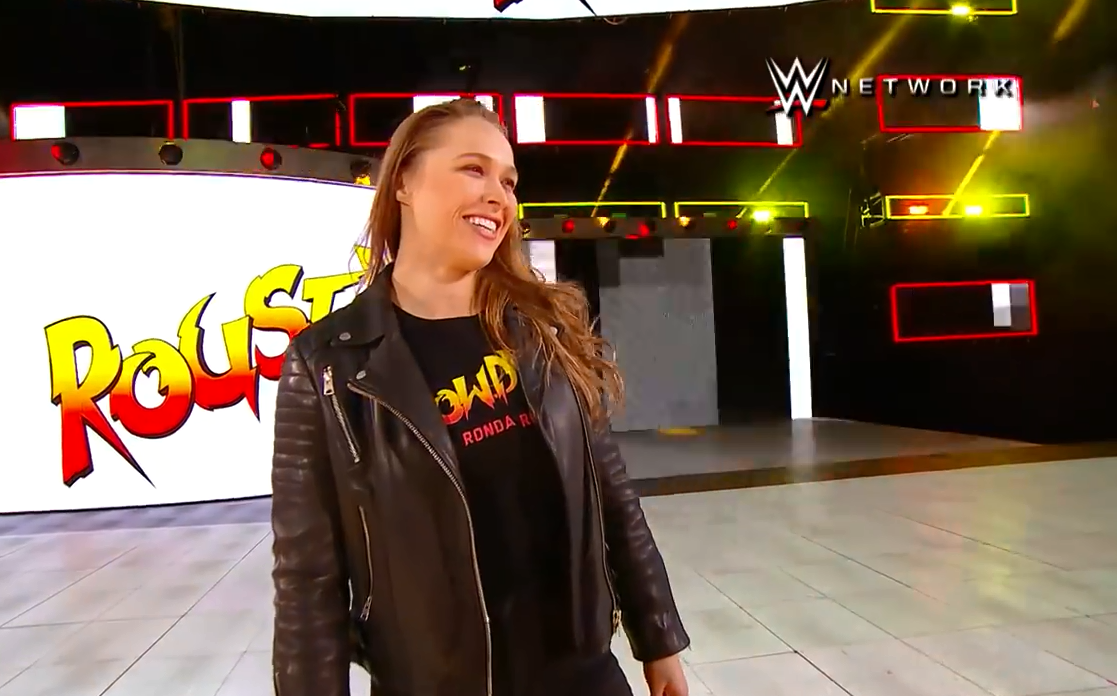 Watch Ronda Rousey Slam Triple H Through A Table At WWE Event