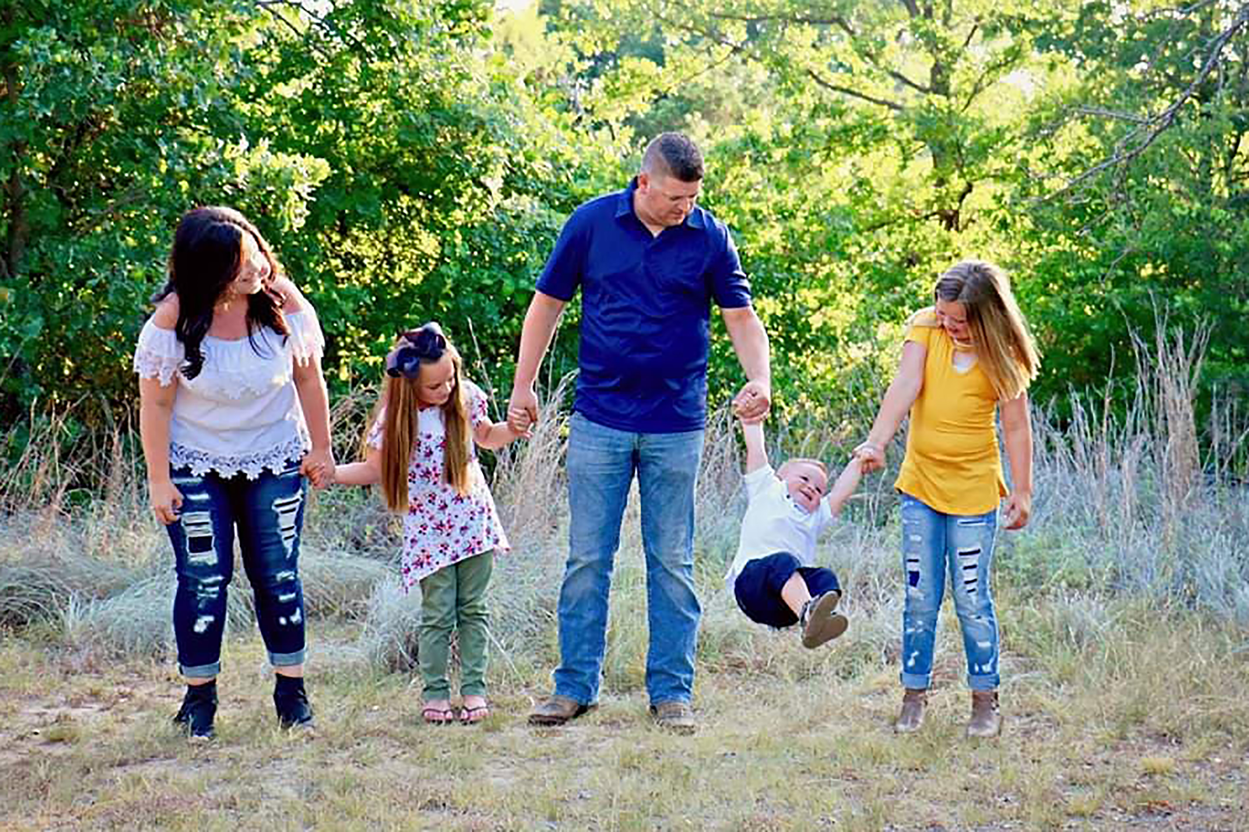 Brittney Sullivan with her husband David Sullivan and their kids Makennah, 10 (right), James, 2 (centre) and Presley, 7 (left). Credit: Caters