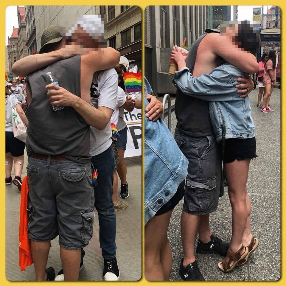 Two people receiving two hugs. Credit: Howie Dittman/Facebook