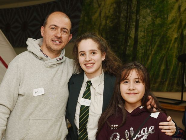 Joao Araujo with his two daughters. Credit: SWNS