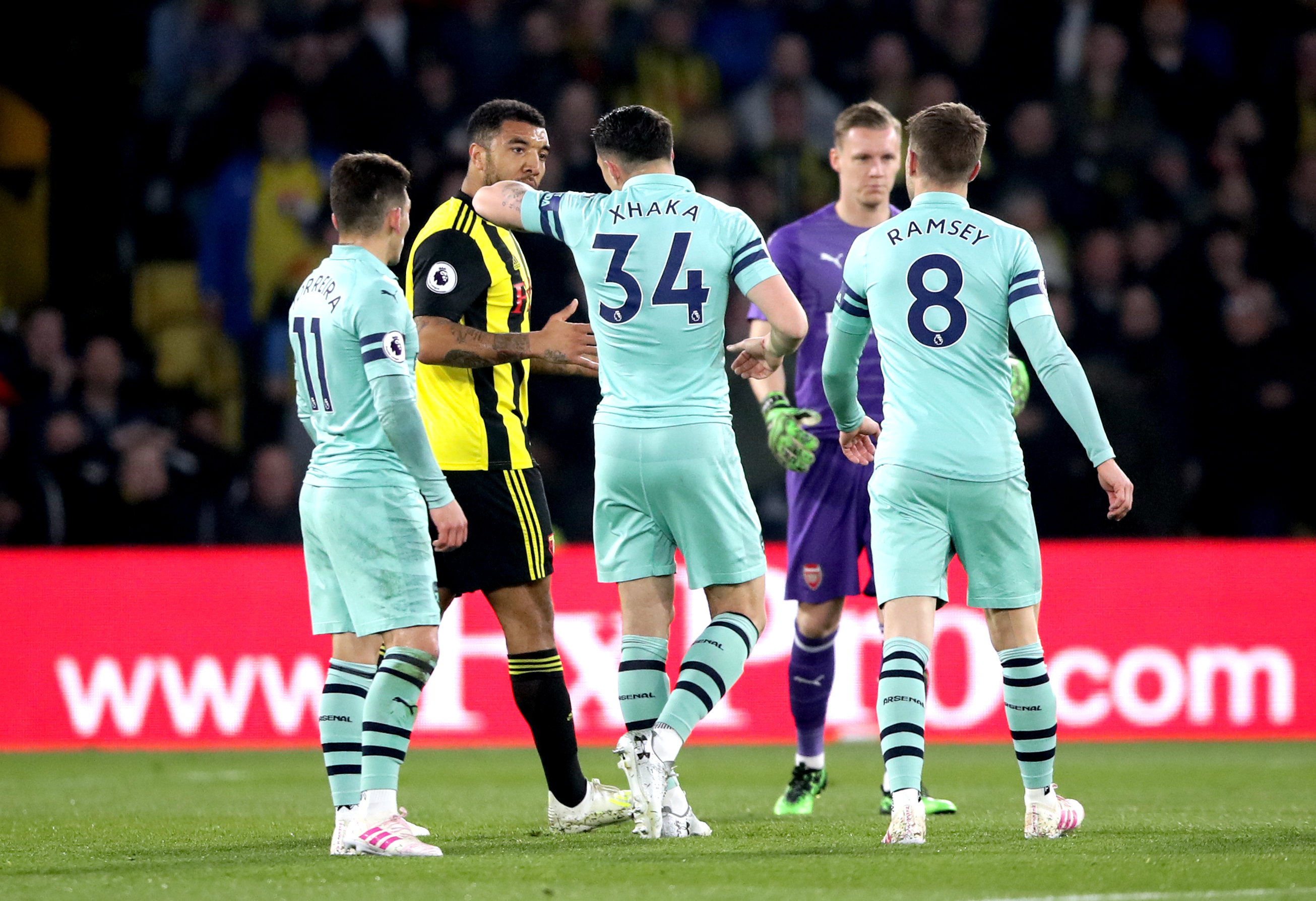 Xhaka explains to Deeney why he's been sent off, as if he didn't know. Image: PA Images