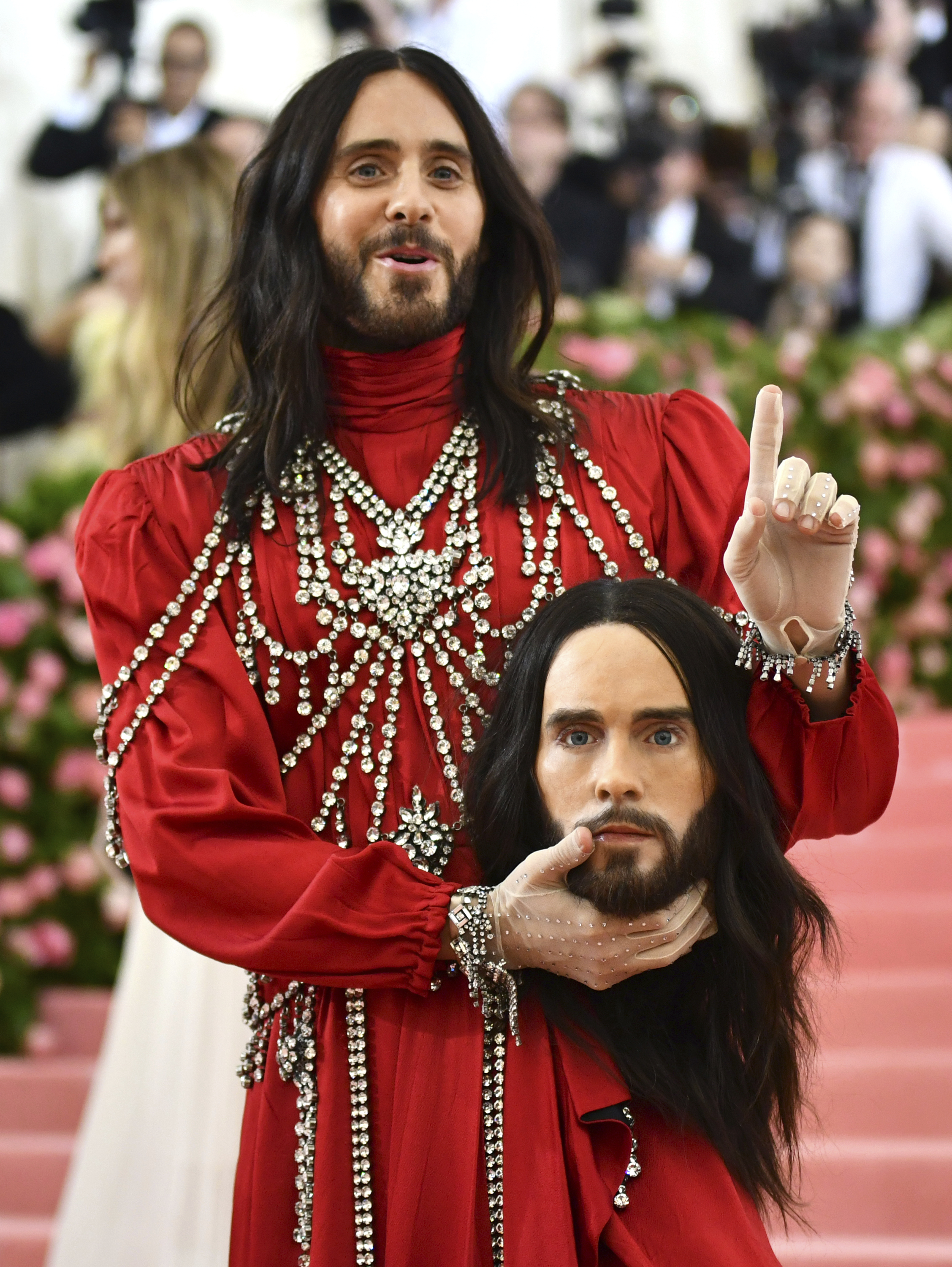 Jared Leto carried a prosthetic head down the red carpet. Credit: PA