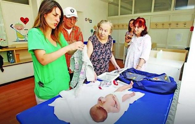 Atifa with new baby Alina