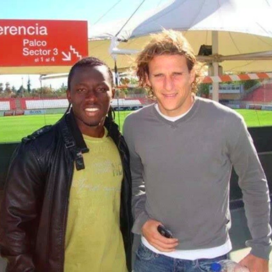 Sadick Adams with Diego Forlan during his days at Atletico Madrid.