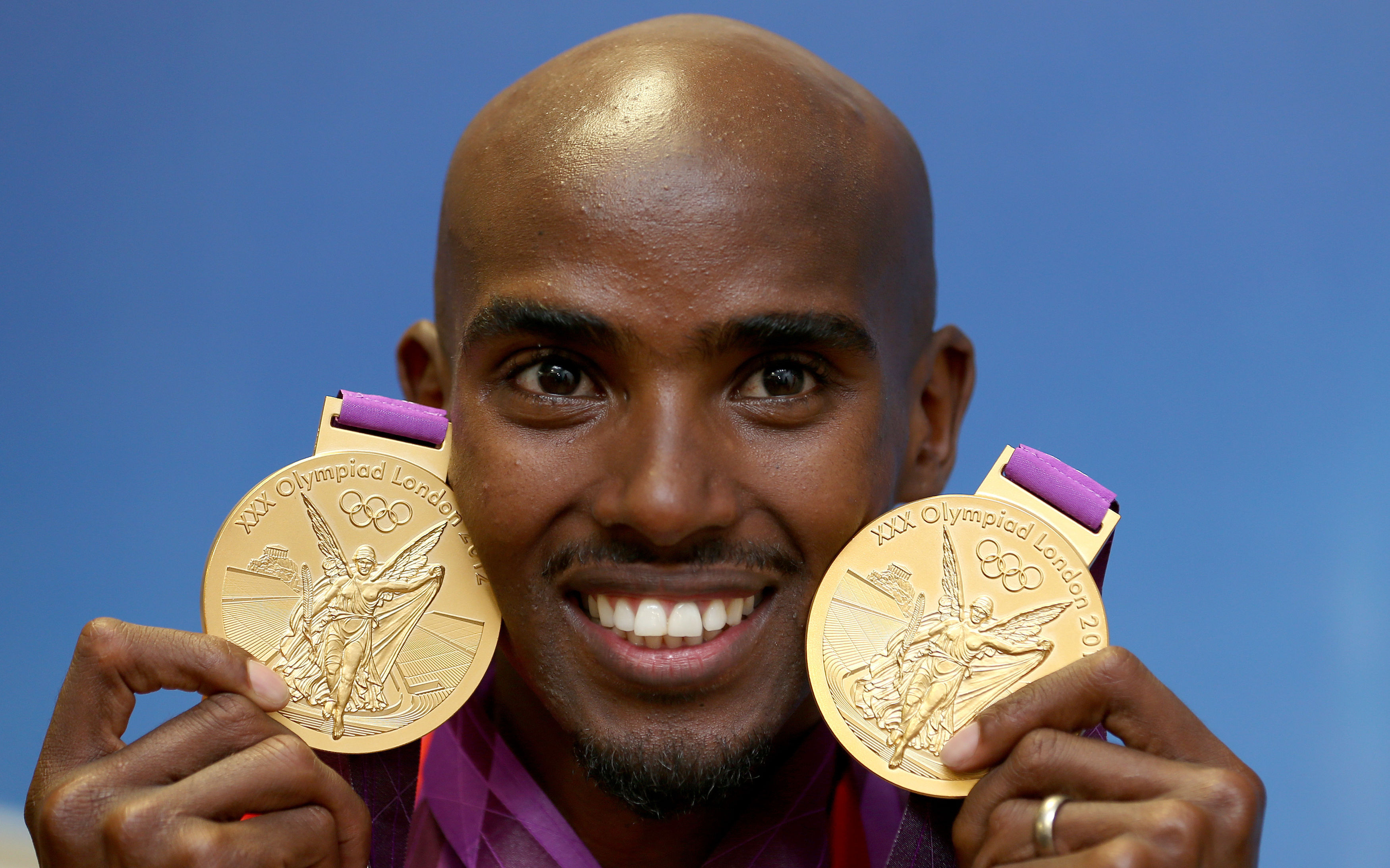 Mo Farah with gold medals