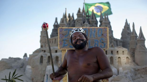 ​Meet The Absolute Legend Who Lives In A Sandcastle On A Beach