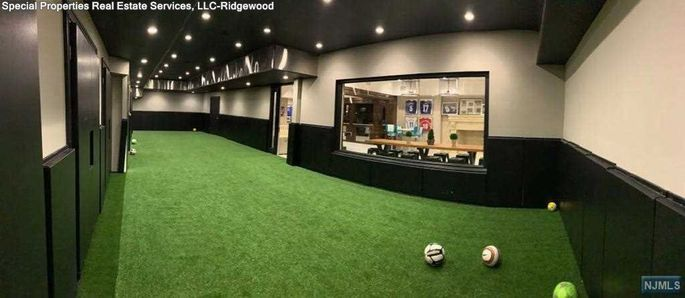Indoor pitch for shooting practice. Image: Realtor