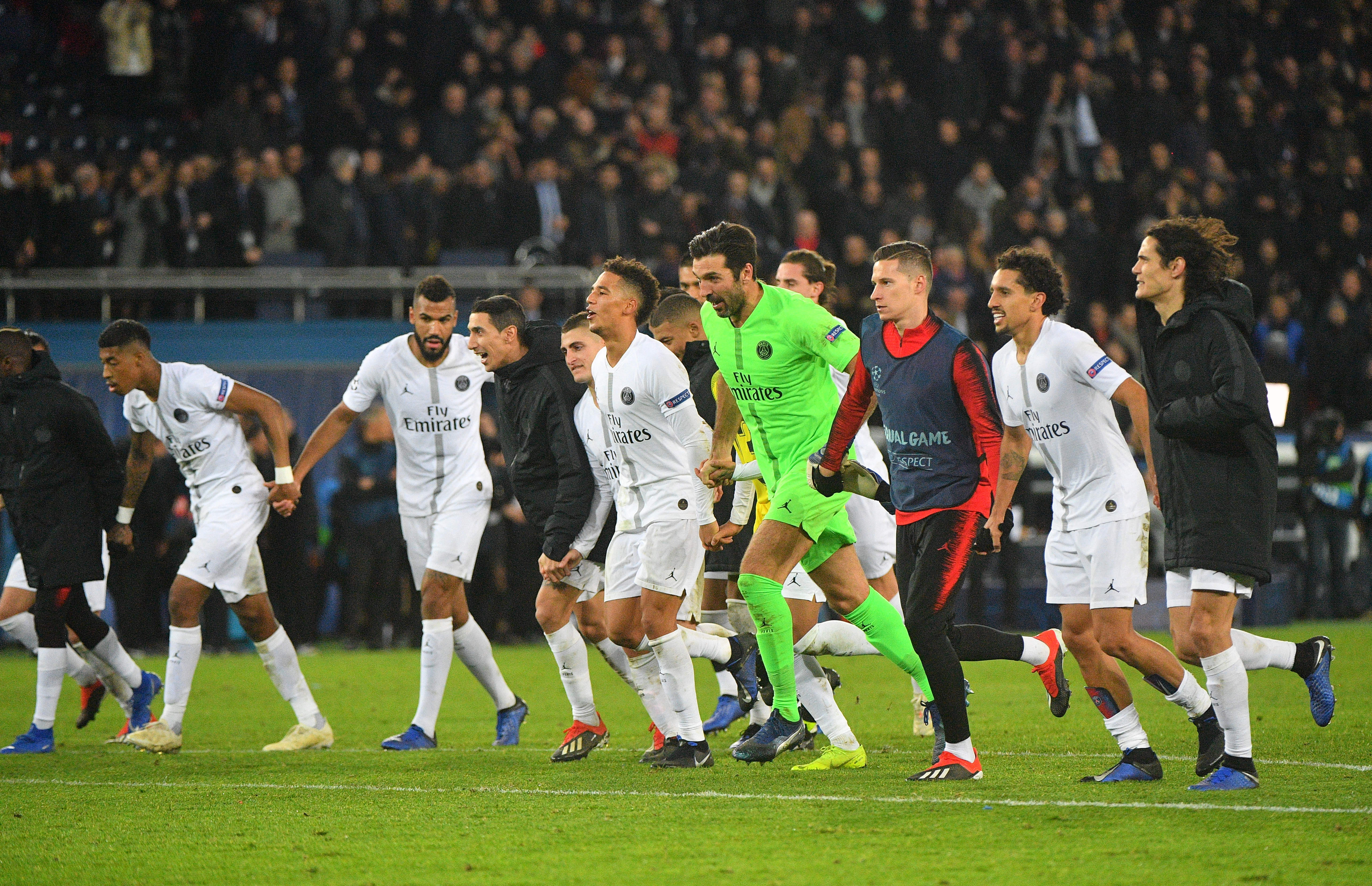 PSG players celebrate the win over Liverpool. Image PA Images