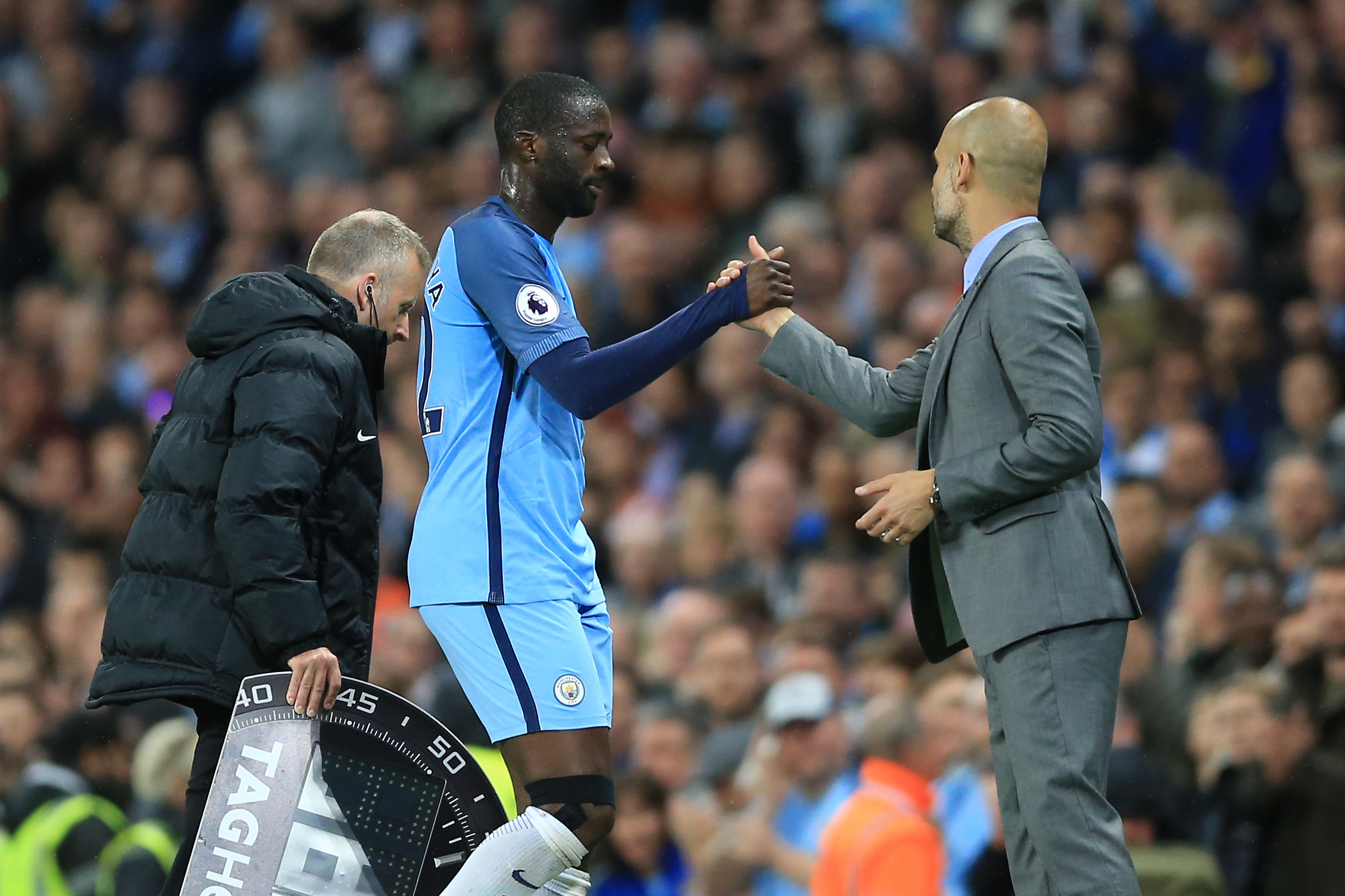 Guardiola and Toure shake hands. Image PA