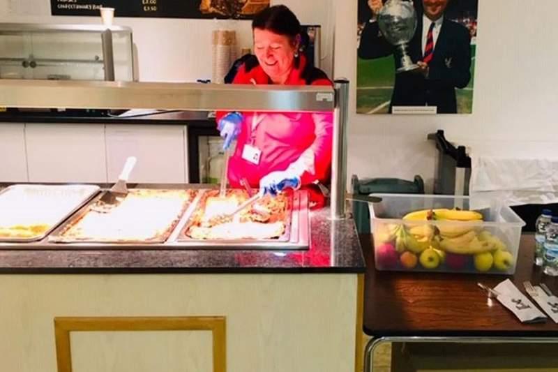 A member of staff serves food. Image: Crystal Palace/Croydon Council