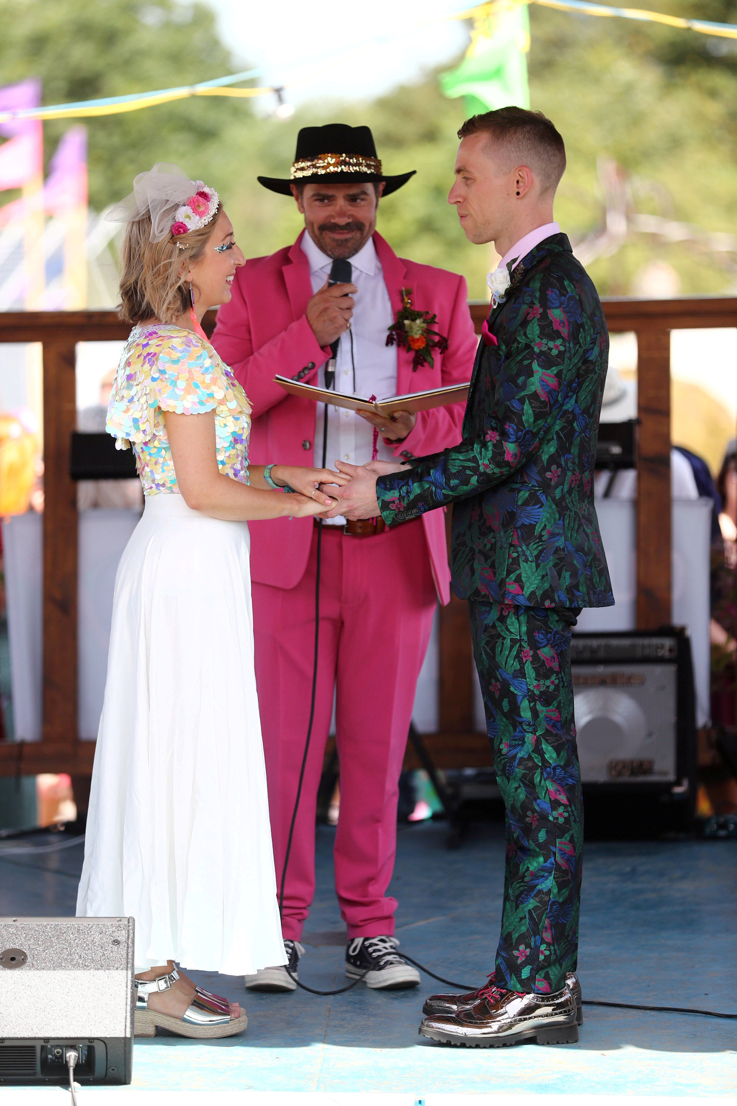 The pair wed in a colourful ceremony at Glasto. Credit: SWNS