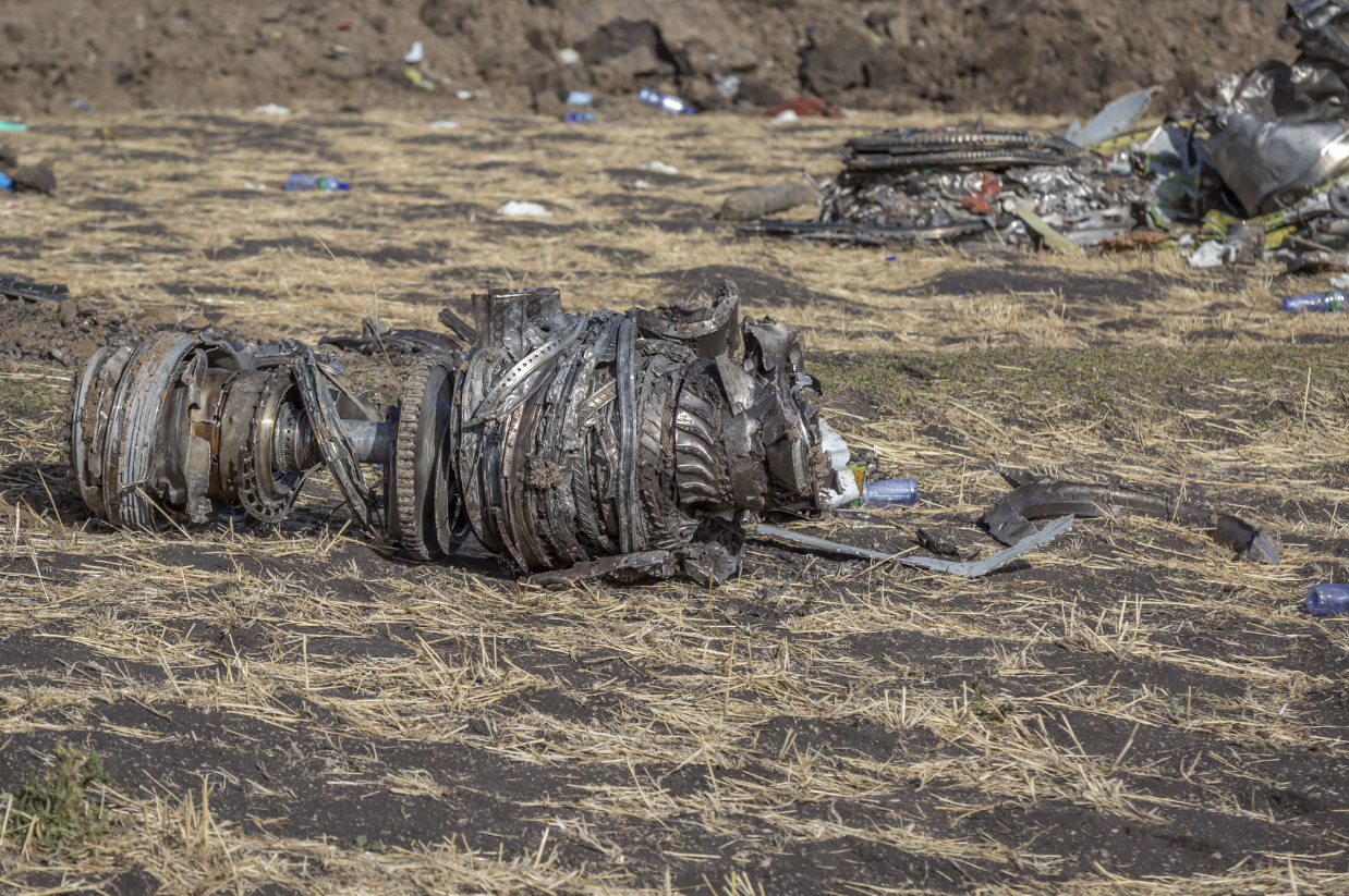 Aeroplane parts on the ground at the scene of an Ethiopian Airlines flight crash. Credit: PA