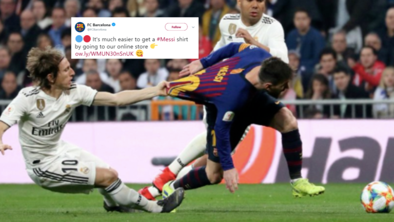 e5f67e761 Barcelona Use Picture Of Luka Modric Pulling Lionel Messi s Shirt To  Promote His Jersey On Official