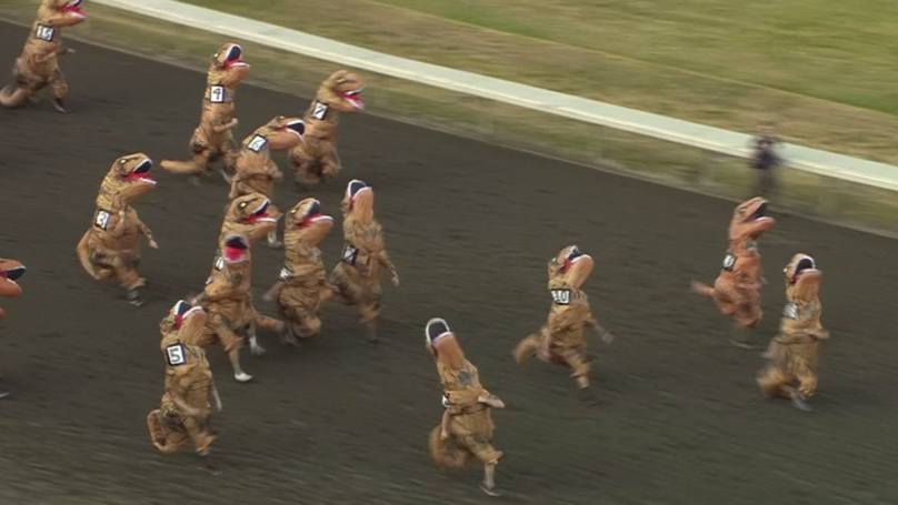 Hilarious Video Shows People In T-Rex Costumes Racing Around Horse Track