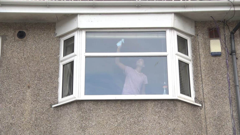 The Photograph Of A Woman Cleaning A Window Is More Sinister Than You Think