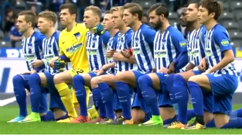 Hertha Berlin Players And Coaches Take A Knee