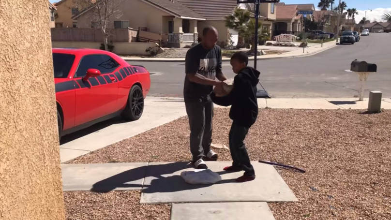 Dad Forces Son To Smash PlayStation 4 With Massive Rock Because Of Bad School Grades